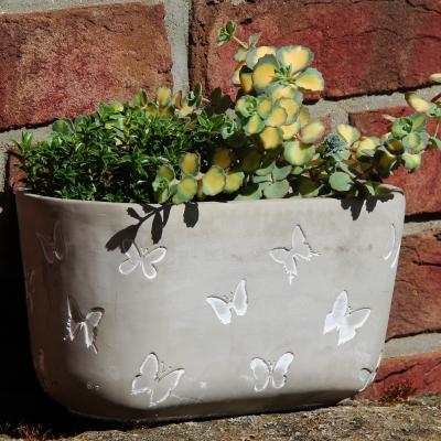 květník beton dekor motýl střední