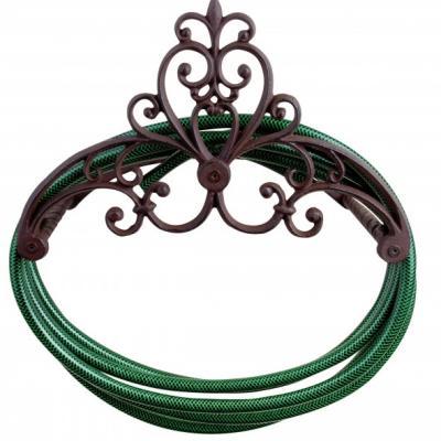 litinový držák na zahradní hadici antik